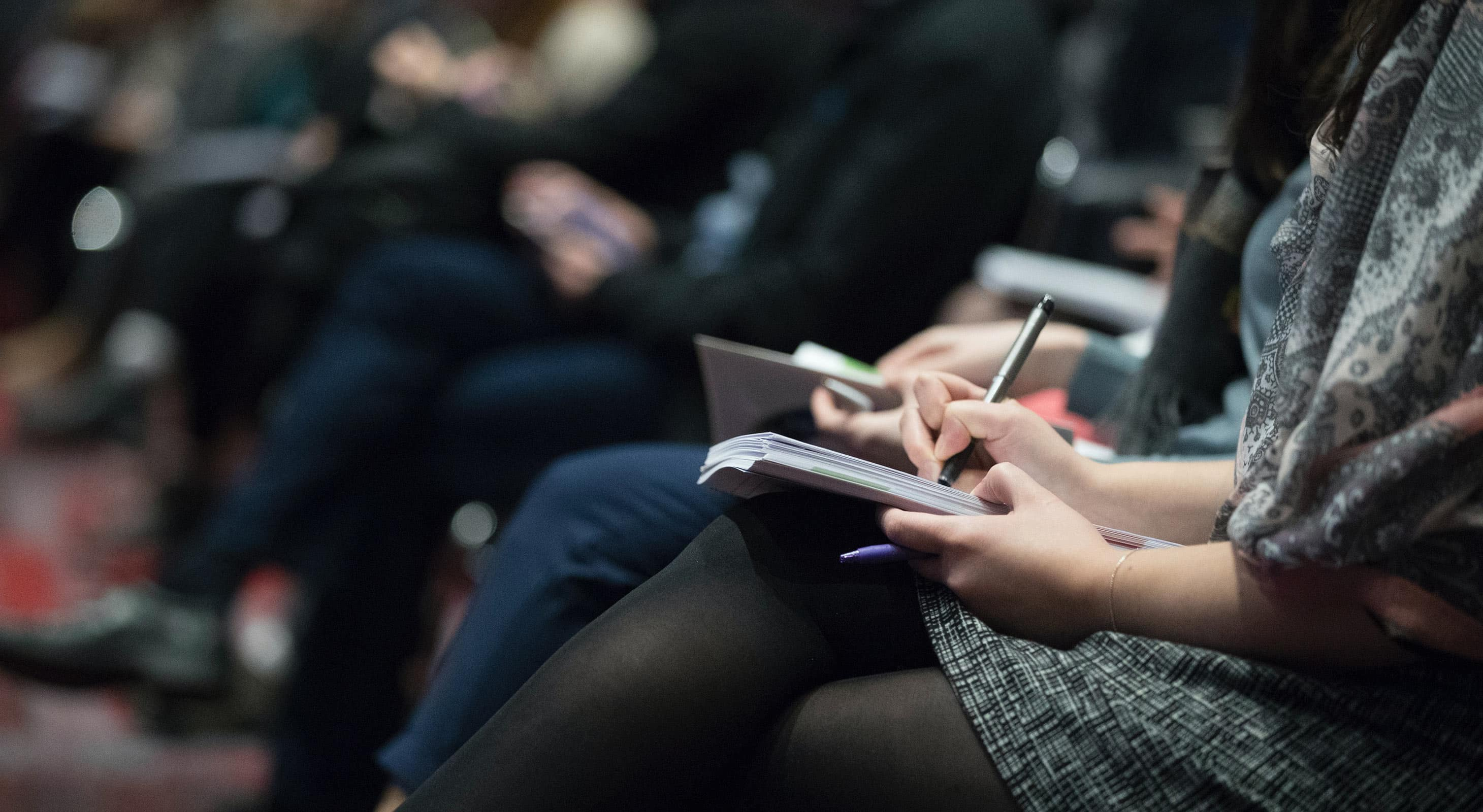 Attendees at a Conference taking notes