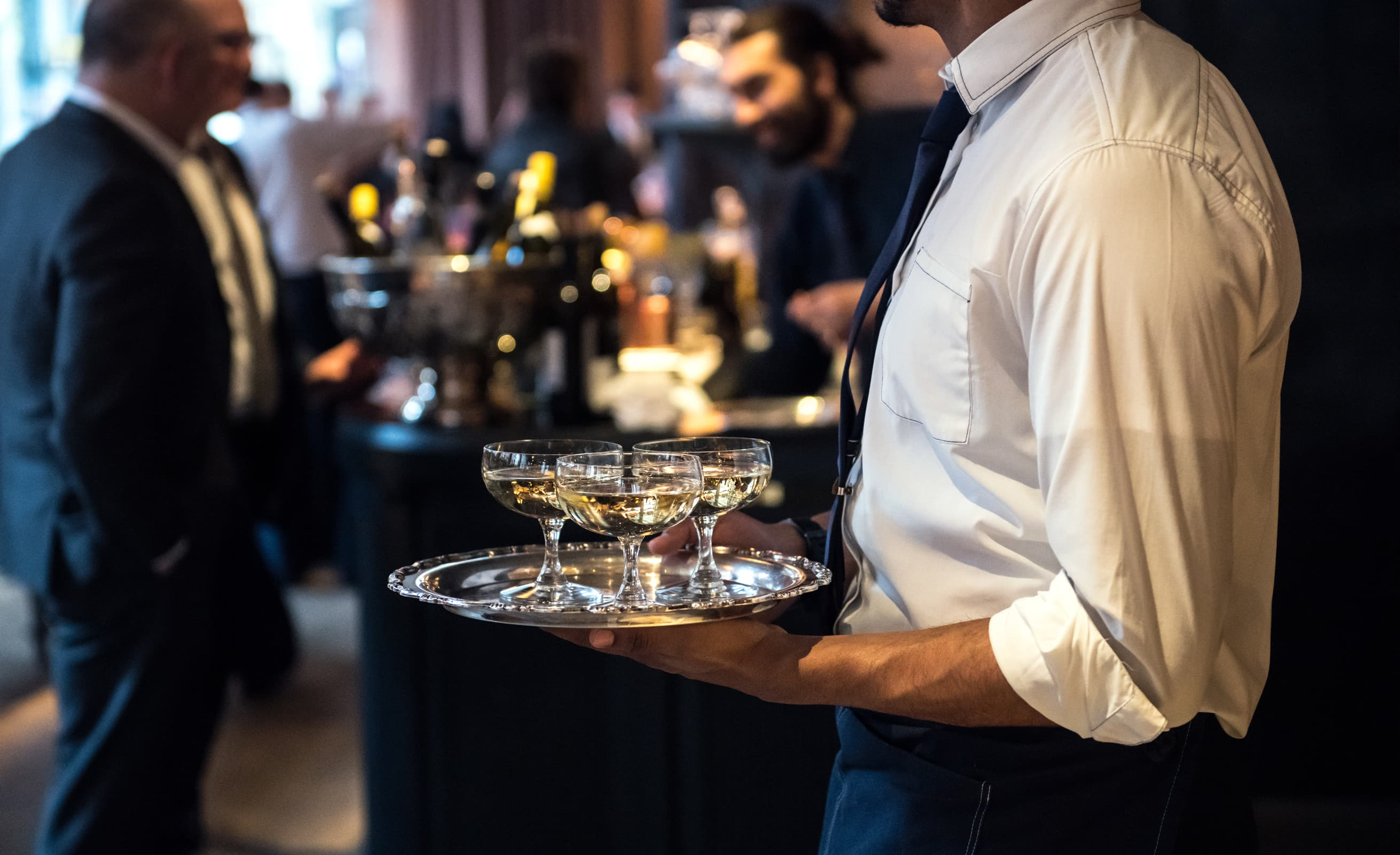 waiter serving Champagne at a wedding